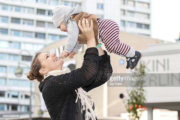 Sophie Schuett and her son Lonzo Henry Schuett pose during a family photo session on September 27 2015 in Berlin Germany