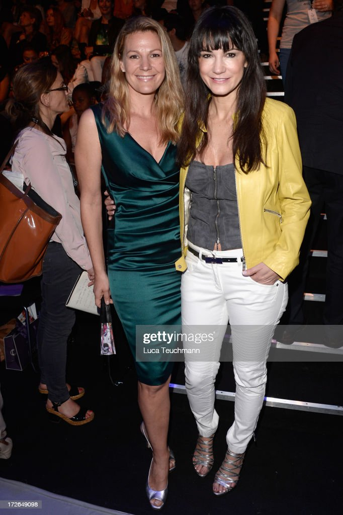 Sophie Schuett and Mariella Ahrens attend the Laurel Show during the Mercedes-Benz Fashion Week Spring/Summer 2014 at Brandenburg Gate on July 4, 2013 in Berlin, Germany.