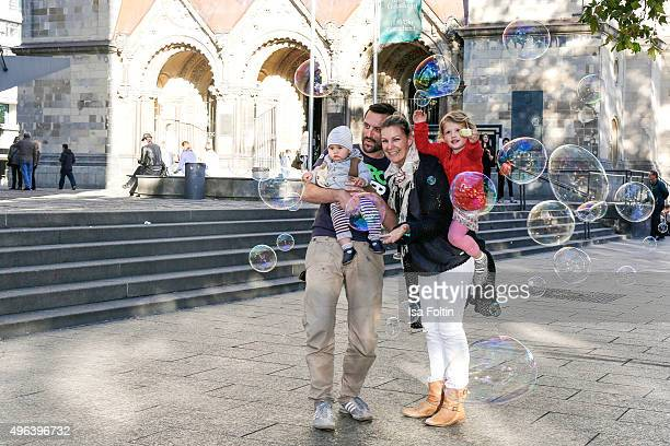 Sophie Schuett her children Shaza Maria Schuett and Lonzo Henry Schuett and her partner Felix Seitz pose during a family photo session September 27...