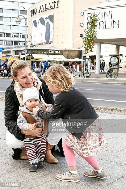 Sophie Schuett her children Shaza Maria Schuett and Lonzo Henry Schuett pose during a family photo session September 27 2015 in Berlin Germany