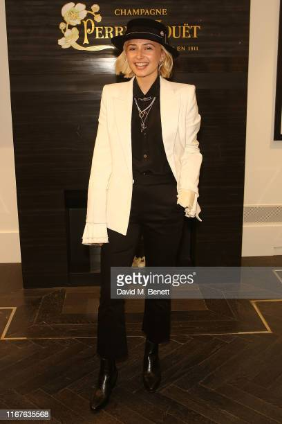 Sophie Simnett attends a London Fashion Week party hosted by Amanda Wakeley to preview her new 'Wakeley Women' portrait series shot by Laura Bailey...