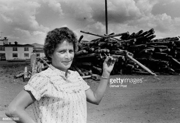 Sophie Stevenson holding the two lengths of matches produced at the Ohio Match Co in Mancos stands in front of part of the 25 million to 3 million...