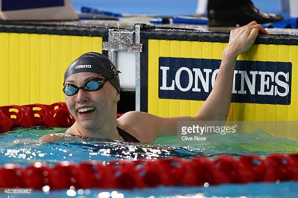 Sophie Taylor of England reacts after winning the gold medal in the Women's 100m Breaststroke Final at Tollcross International Swimming Centre during...