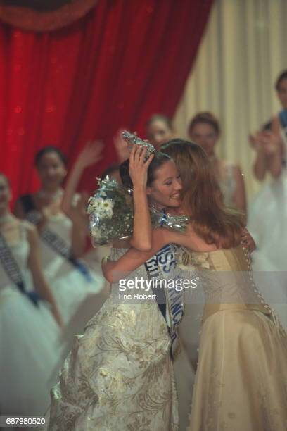 Sophie Thalmann Miss France 1998 hands on her crown to the winner Mareva Galantier Miss Tahiti