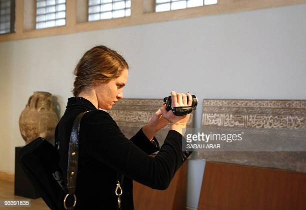 Sophie the daughter of Google chief executive Eric Schmidt uses her camcorder as she visits the recentlyrestored National Museum where her father...