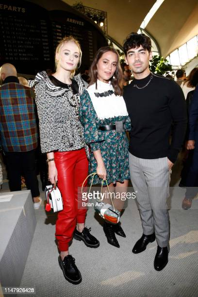 Sophie Turner , Alicia Vikander and Joe Jonas attend the Louis Vuitton Cruise 2020 Fashion Show at JFK Airport on May 08, 2019 in New York City.
