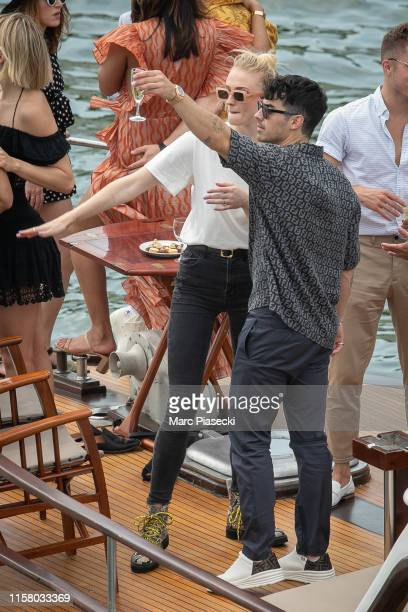 Sophie Turner and Joe Jonas are seen aboard the boat 'Shivas' while on a cruise with Priyanka Chopra Nick Jonas and friends on the river Seine on...