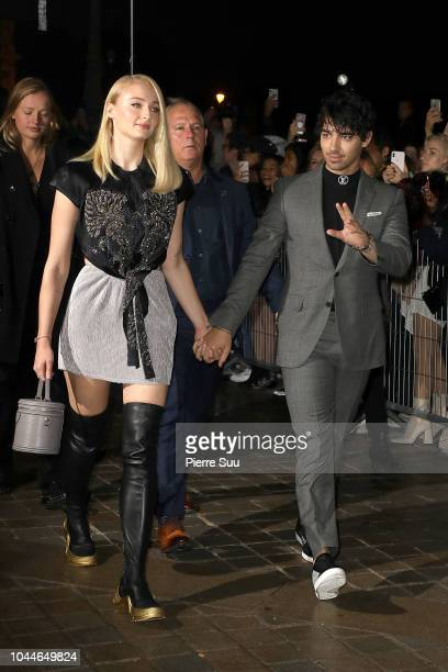 Sophie Turner and Joe Jonas arrive at the Louis Vuitton show as part of the Paris Fashion Week Womenswear Spring/Summer 2019 on October 2, 2018 in...