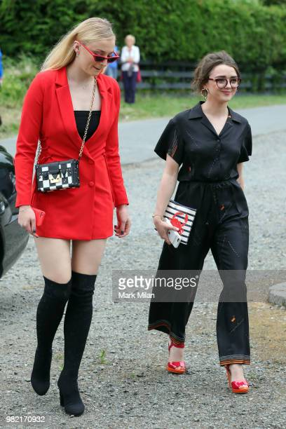 Sophie Turner and Maisie Williams arriving at Rayne Church in Kirkton on Rayne for the wedding of Kit Harrington and Rose Leslie on June 23 2018 in...