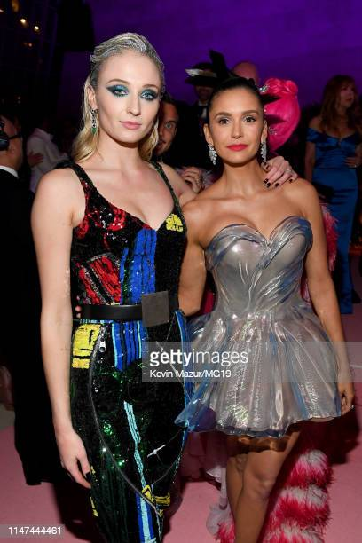 Sophie Turner and Nina Dobrev attend The 2019 Met Gala Celebrating Camp Notes on Fashion at Metropolitan Museum of Art on May 06 2019 in New York City