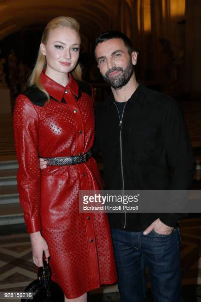 Sophie Turner and Stylist Nicolas Ghesquiere pose after the Louis Vuitton show as part of the Paris Fashion Week Womenswear Fall/Winter 2018/2019 on...