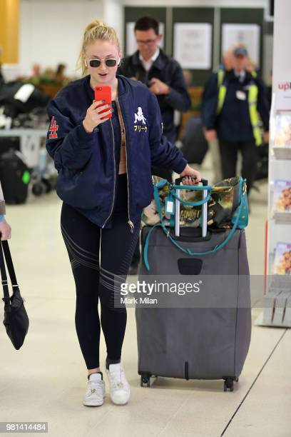 Sophie Turner arriving at Aberdeen Airport facetiming Joe Jonas before the wedding of Kit Harrington and Rose Leslie on June 22 2018 in Aberdeen...