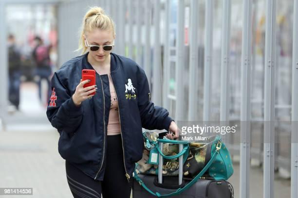 Sophie Turner arriving at Aberdeen Airport facetiming Joe Jonas before the wedding of Kit Harrington and Rose Leslie on June 22 2018 in Aberdeen...
