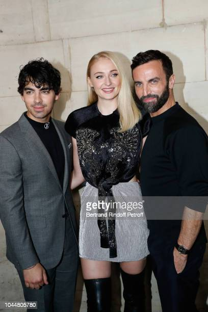 Sophie Turner Joe Jonas and Stylist Nicolas Ghesquiere pose after the Louis Vuitton show as part of the Paris Fashion Week Womenswear Spring/Summer...