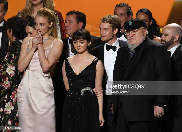 Sophie Turner, Maisie Williams, Alfie Allen, and George R. R. Martin accept the Outstanding Drama Series award for 'Game of Thrones' onstage during...