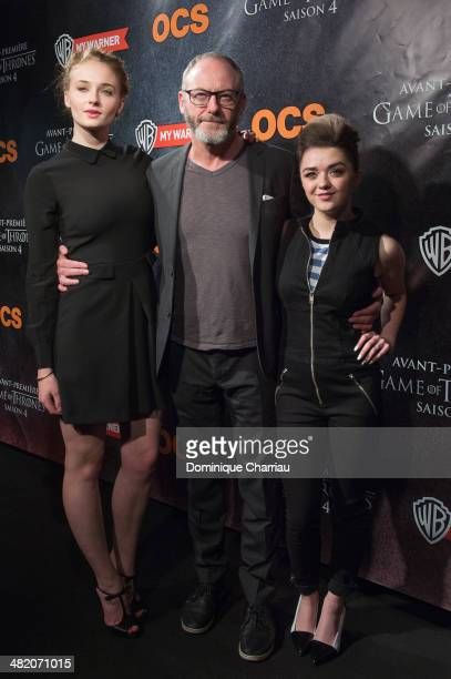 Sophie Turner Maisie Williams and Liam Cunningham attend the 'Game of Thrones Season 4' Paris premiere at Le Grand Rex on April 2 2014 in Paris France