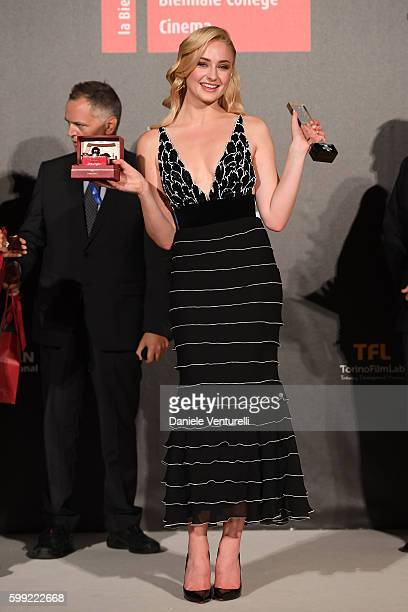 Sophie Turner poses with the Kineo International Movie Award at the Kineo Diamanti Award Ceremony during the 73rd Venice Film Festival on September...