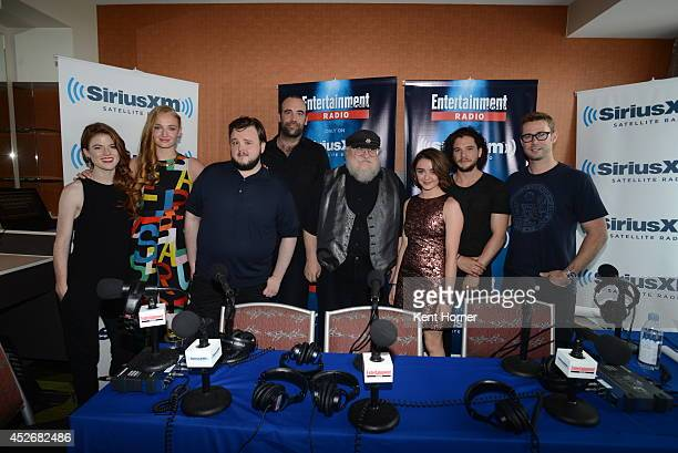 Sophie Turner Rose Leslie John Bradley Rory McCann George RR Martin Maisie Williamss and Kit Harrington pose with radio host Matt Bean after being...
