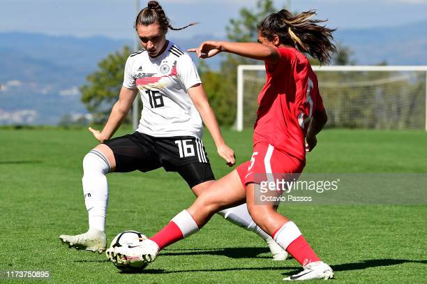 Sophie Weidauer of Germany competes for the ball with Neslihan Bozkaya of Azerbaijan during the UEFA Women's U19 European Championship Qualifier...