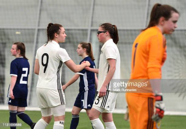 Sophie Weidauer , of Germany is congratulated by team mate Julia Pollak of Germany after scoring in the second half during the UEFA Elite Round match...