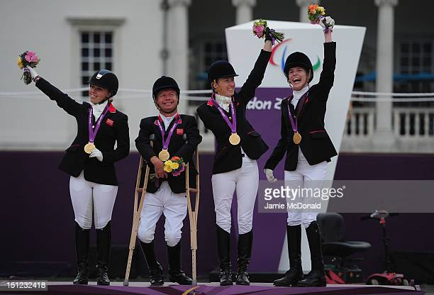 Sophie Wells Lee Pearson Deborah Criddle and Sophie Christiansen of Great Britain win Team Gold during the Equestrian Event on day 6 of the London...
