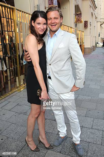 Sophie Wepper and David Meister attend the Eclat Dore summer party at Hotel Vier Jahreszeiten Kempinski on July 23 2014 in Munich Germany