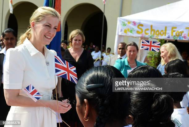 Sophie wife of Britain's Prince Edward speaks with children during a meeting with students of Sri Lanka's schools for the deaf and blind near the...