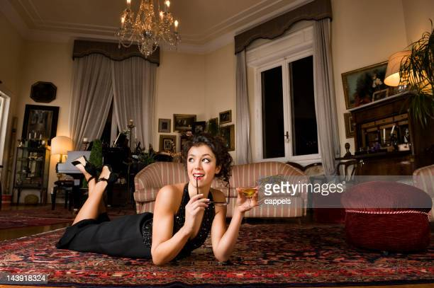 sophisticated girl holding a glass of martini.color image - persian rug stock photos and pictures