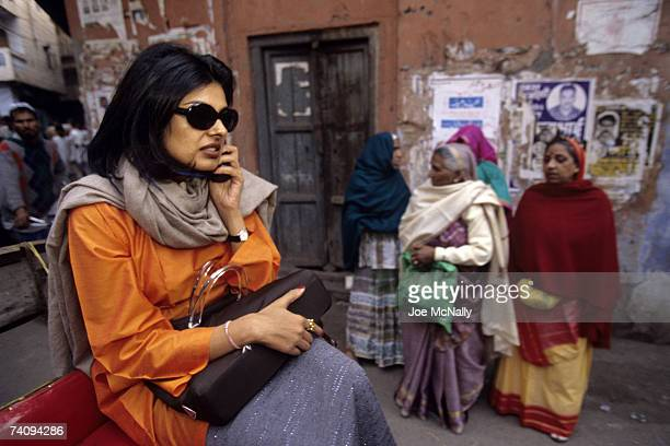 Sophisticated Indian woman rides through the streets in January of 1999 on her cellphone in New Delhi India The Indus Valley civilization from which...