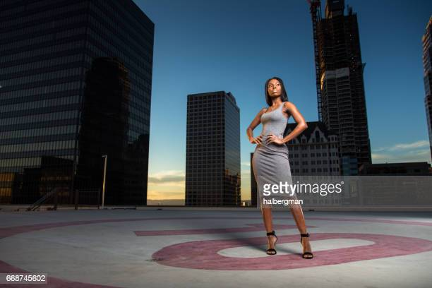 Sophisticated Woman Looking Out on City from Helipad