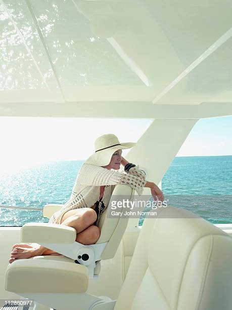 Sophisticated women relaxing on yacht