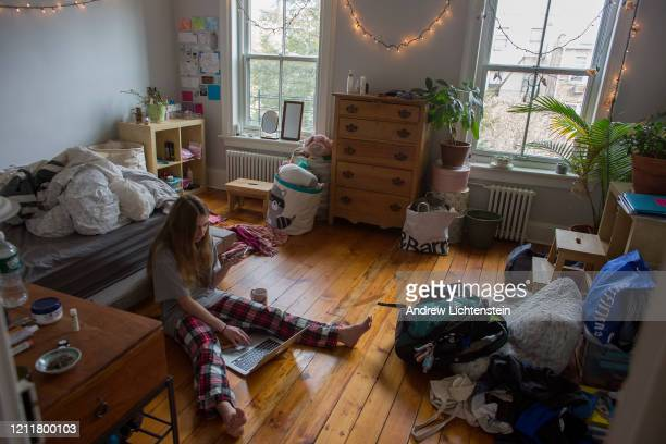 A sophomore at Brooklyn Friends School checks into her classes remotely from home after the school announced that it will be closed due to concerns...