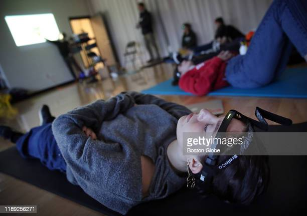 Sophomore Lucinda Beard meditates during a mindfulness class at the Cambridge School of Weston in Weston MA on Nov 13 2019 Instructor Gustavo Brasil...