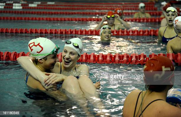 Sophomore Missy Franklin jokes with teammate, Katie Bell, while working at Regis Jesuit High School in Aurora, CO, Wednesday, February 2011. Missy...