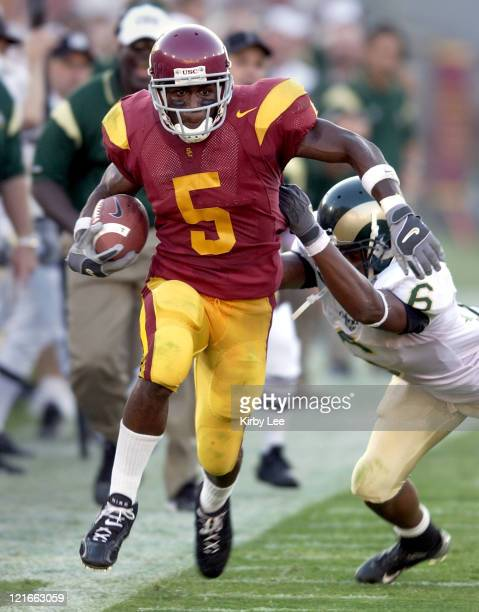 Sophomore tailback Reggie Bush tries to elude Robert Herbert of Colorado State in the second quarter of 49-0 victory at the Los Angeles Memorial...
