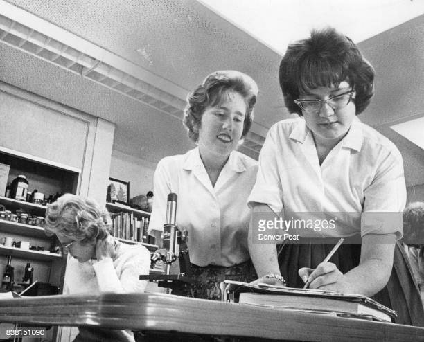 Sophomores Dione Dupree 90 S Ammons St and Rita Thaemert 1360 Forest St work on their science lesson in the laboratory Credit Denver Post