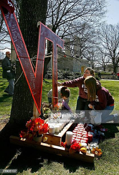 Sophomores Heather Stogdale Heidi Dull and Anne Carlisle Strole all of Stanton Virgina stop to mourn at a makeshift memorial on the campus of...