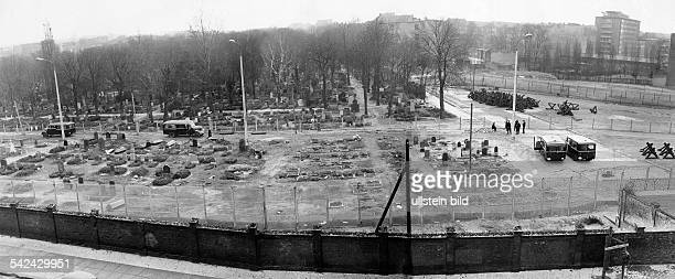 Sopien Cemetery on the eastern side of Bernauer Strasse workers remove graves that lie near the Berlin Wall in order to modernize the border...