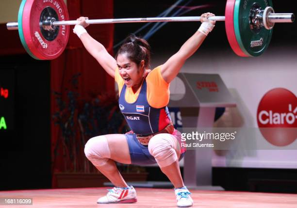 Sopita Tanasan of Thailand A competes in the Women's 53kg snatch during day two of the 2013 Junior Weightlifting World Championship at Maria Angola...