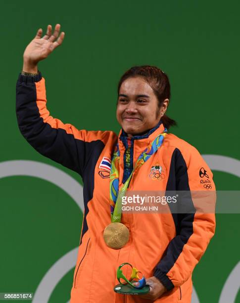 TOPSHOT Sopita Tanasan of Thailand waves to her fans from the podium after receiving the gold medal in the medal ceremony of the women's...