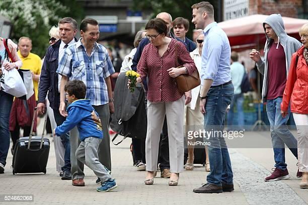Sopot, Poland 27th, June 2015 Prime Minister Ewa Kopacz visits Sopot. PM arrived to Sopot by train, visited Breakfast Market drank some coffe, eat...