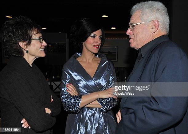 Soprano Angela Gheorghiu poses with Eva and Marc Stern at La Botte on March 17 2013 in Santa Monica California