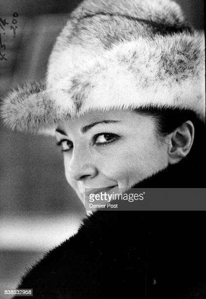 Soprano Anna Moffo of the Metropolitan Opera dressed in black and white fur for her Denver airport arrival will appear here at 8 pm' Friday and...