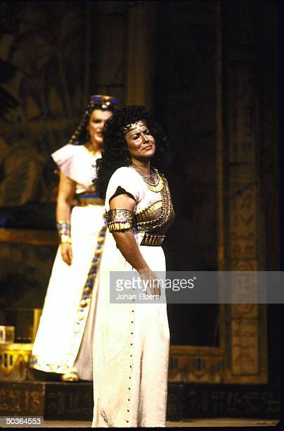 Soprano Aprile Millo in the title role w unident singer as Amneris in a scene fr Verdi's Aida on stage at the Metropolitan Opera