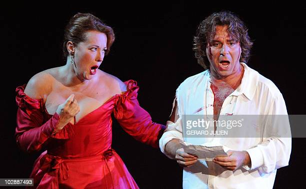 Soprano Catherine Naglestad as Floria Tosca and Franco-Italian tenor Roberto Alagna as Mario Cavaradossi perform during the rehearsal of Italian...