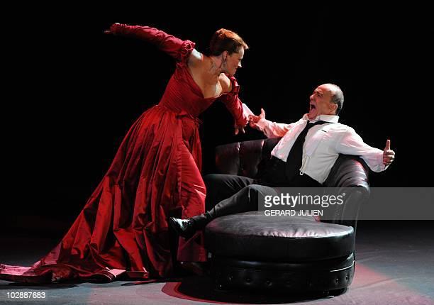 Soprano Catherine Naglestad as Floria Tosca and German bass-baritone Falk Struckmann as Il Barone Scarpia perform during the rehearsal of Italian...