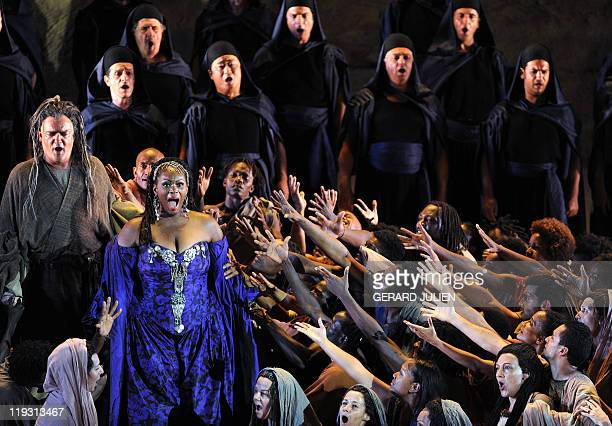 Soprano Indra Thomas playing the role of Aida and Polish baryton Andrzej Dobber as Amonasro perform during the rehearsal of Italian Giuseppe Verdi...