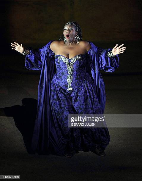 US soprano Indra Thomas playing the role of Aida performs during the rehearsal of Italian Giuseppe Verdi opera 'Aida' on July 7 in Orange southern...