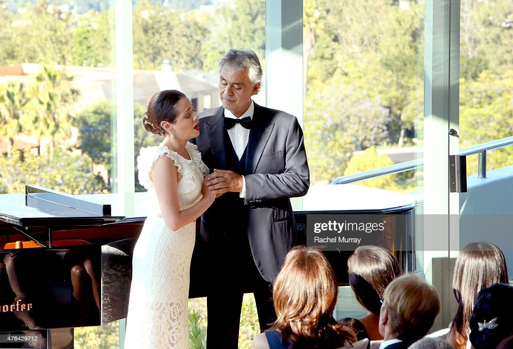 Soprano Maria Aleida (L) and Maestro Andrea Bocelli perform a private concert for guests during Alfred Mann Foundation's an Evening Under The Stars with Andrea Bocelli on June 8, 2015 in Los Angeles, California.