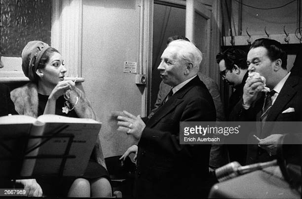 Soprano Maria Callas conductor Tullio Serafin and tenor Luigi Tagliavini in the playback room at Kingsway Hall London listening to a recording of...